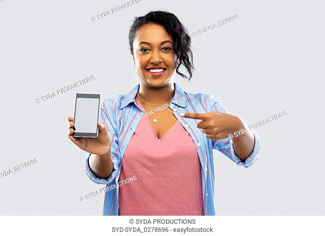 happy african american woman showing smartphone