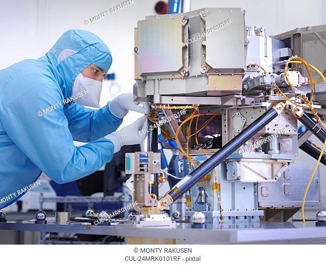 Worker building satellite dish