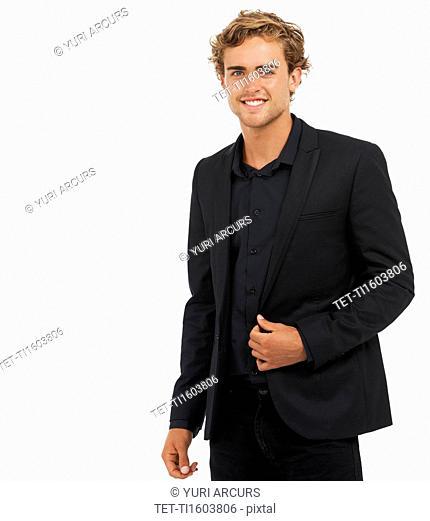 Studio Shot of young man wearing black jacket and shirt