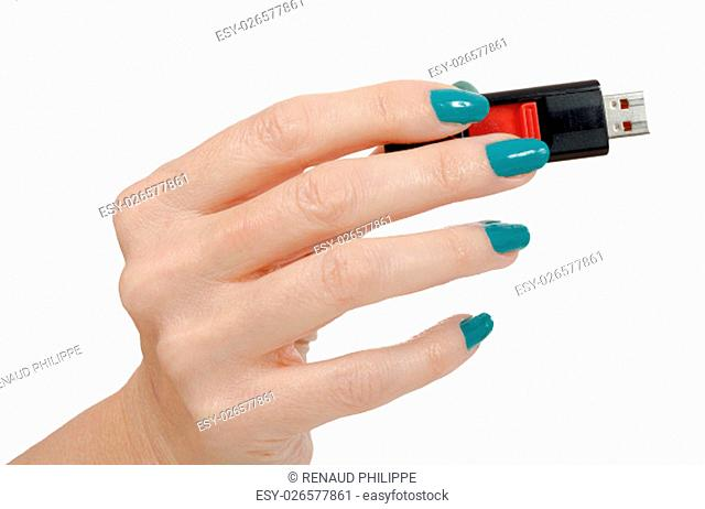Woman hand holding up a flash drive isolated on a white background