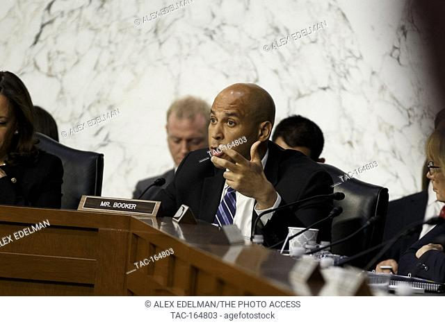 Senator Cory Booker, Democrat of New Jersey, asks Facebook CEO Mark Zuckerberg a question as he testifies before the United States Senate on Capitol Hill in...