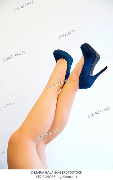 Woman's legs wearing high-heel shoes