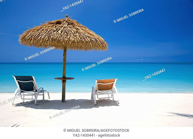 Barbuda Umbrellas and sunloungers at Lighthouse Bay Resort
