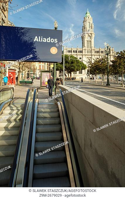 Entrance to Aliados metro station in Porto, Portugal. City Hall in the distance