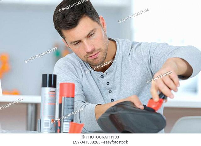 Man polishing shoes