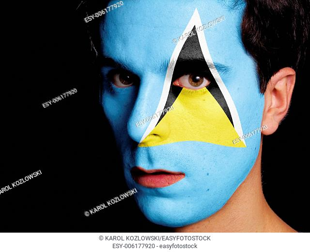 Flag of Saint Lucia Painted on a Face of a Young Man