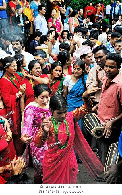 On the day of Teej festival at Pachali Bhairab Temple There were many groupes of people were dancing traditional dance, Kathmandu Nepal