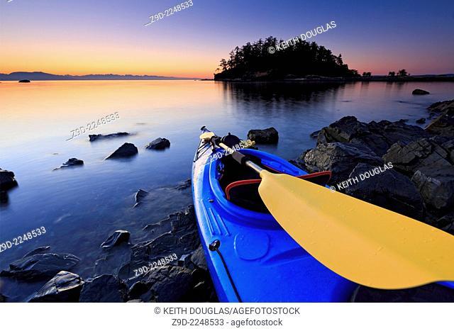 Sea kayak scene at sunrise, Pipers Lagoon Park, Nanaimo, Vancouver Island, British Columbia