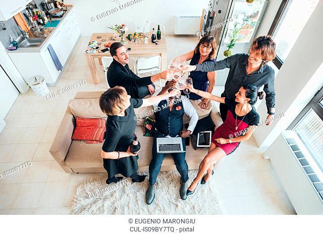 Businessmen and businesswomen toasting wine in loft office
