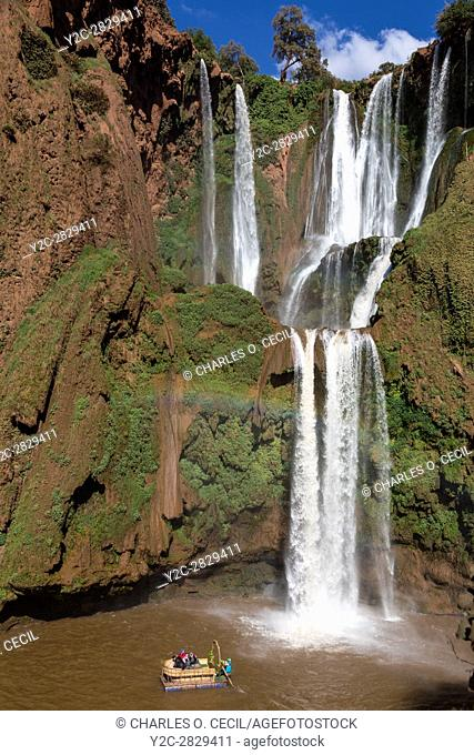 Falls of Ouzoud, Cascades d'Ouzoud, Morocco. Raft with Tourists Paddles Close to the Falls