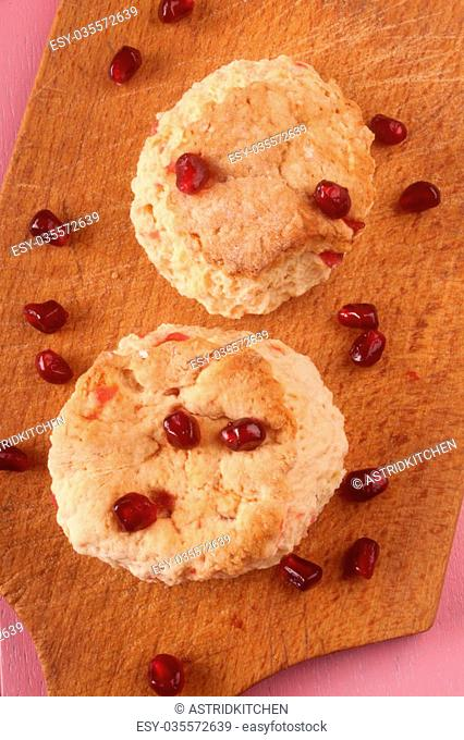 fruit scone with pomegranate seed on a wooden board