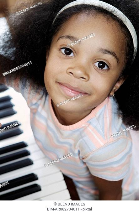 Portrait of girl sitting at piano