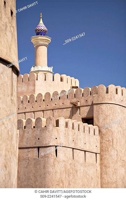 General view of Nizwa Fort with the minaret of the As Sultan Qaboos Mosque in the background, Al Jinah, Nizwa, Ad Dakhiliyah Governorate, Oman
