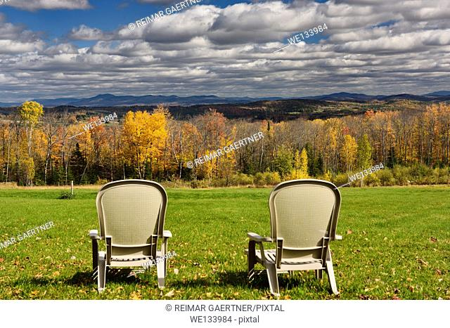 Two lawn chairs at Green Bay Loop overlooking Peacham and Barnet hills Vermont with Fall colors