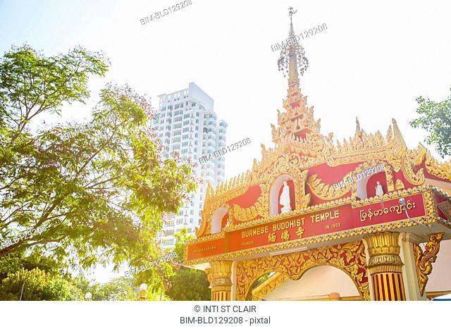 Dhammikarama Burmese temple under sunny sky, George Town, Penang, Malaysia