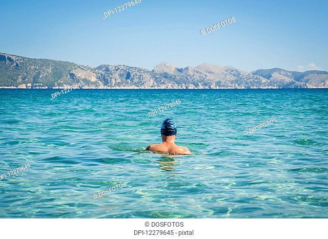 Back of a male swimmer; Cala Sant Joan, Alcudia, Mallorca, Spain