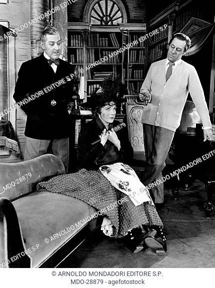 Julie Andrews, Rex Harrison and Reid Shelton in My Fair Lady. The British actor Rex Harrison (Reginald Carey Harrison) and the American actor Reid Shelton...