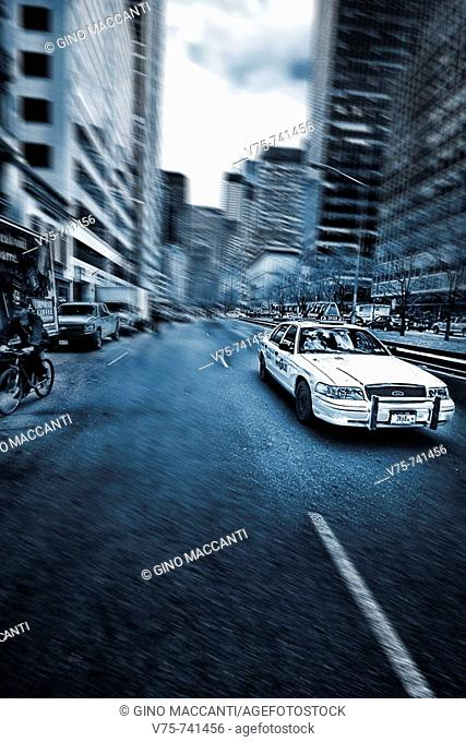 Cab rushing on the street, Manhattan, NYC, USA