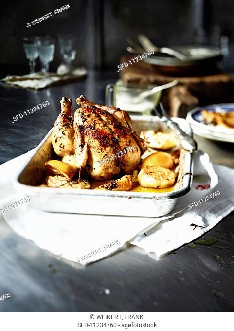 Roast chicken with lemons, onions and thyme