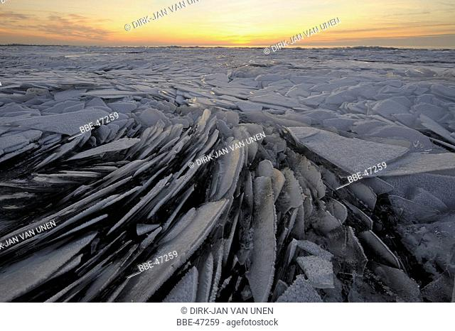 Drifting ice on the Markermeer at sunset