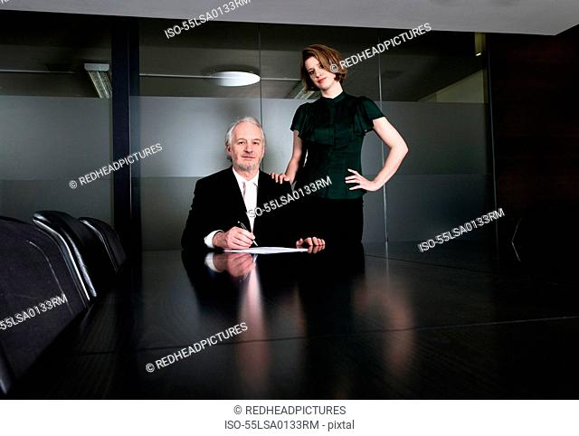 Two business executives with laptop