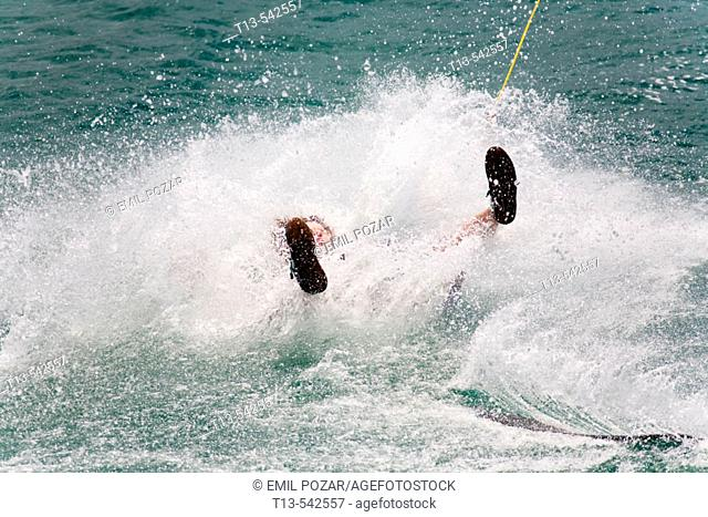 Almost submerged wakeboarder in a splash of water