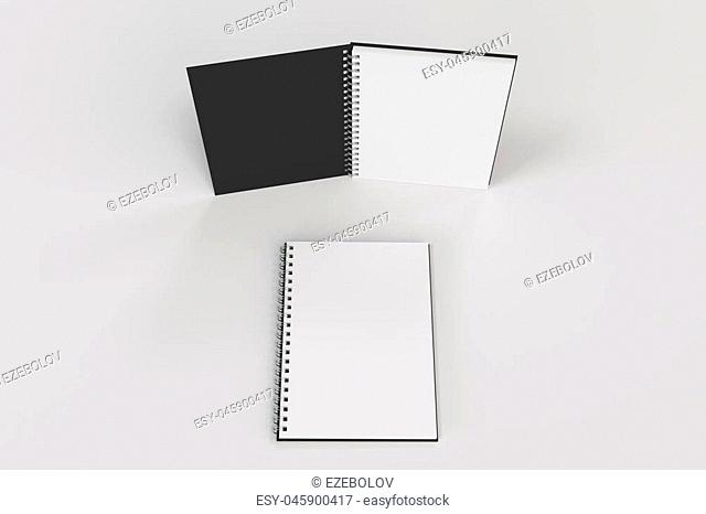 Two opened blank notebooks with black cover and metal spiral bound on white background. Business or education mockup. 3D rendering illustration