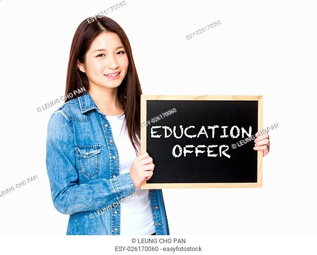 Woman with chalkboard showing education offer