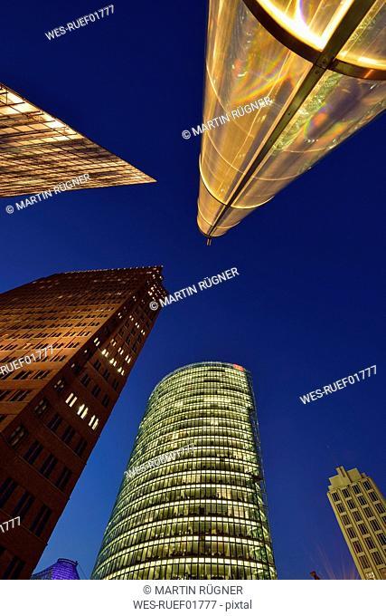 Germany, Berlin, Potsdamer Platz, skyscrapers illuminated at dusk