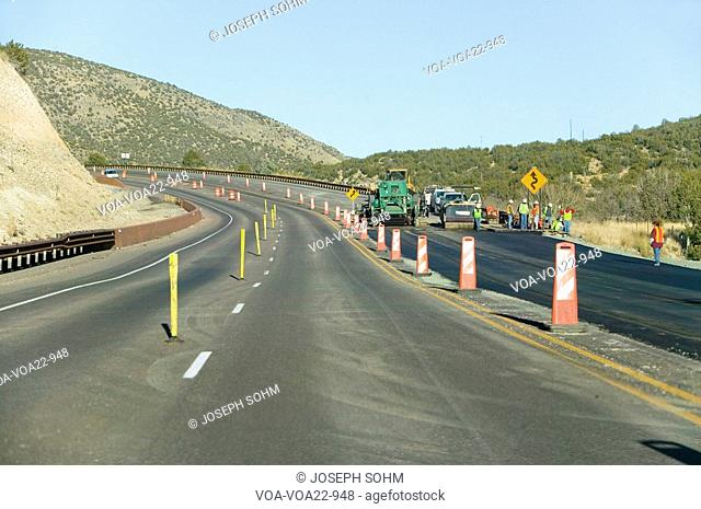 Highway workers work on state highway on Mescalero Apache Indian Reservation near Ruidoso and Alto, New Mexico