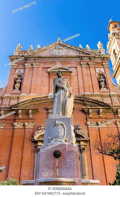 Statue in front of the Santo Tomas church in Valencia, Spain