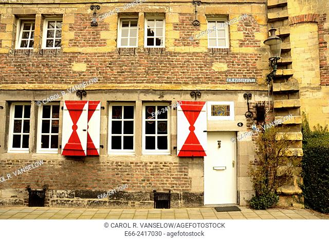 building in Failluzusterspark in the old city of Maastricht close to the old city wall. The red and white shutters on the windows are typical of Maastricht