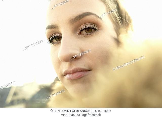 headshot portrait of woman, in Munich, Germany