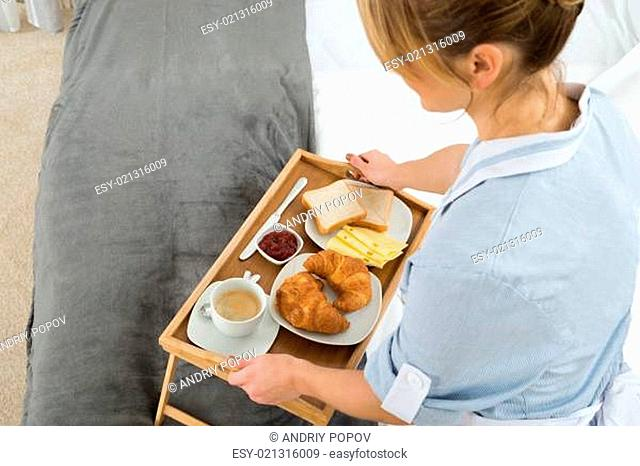 Close-up Female Maid With Breakfast Tray In Bedroom