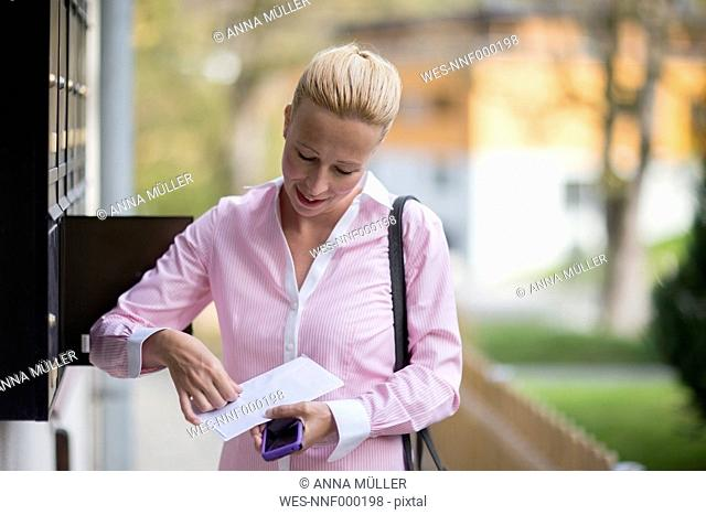 Woman opening letter