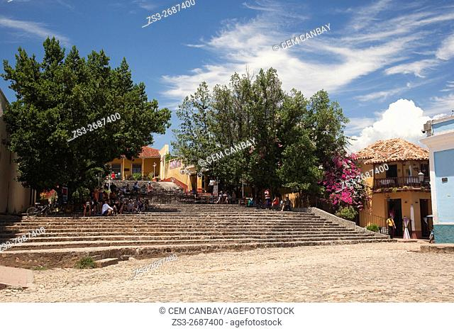 Tourists at the stairs of Casa De La Musica-Music House at Plaza Mayor-Main Square, Trinidad, Sancti Spiritu Province, Cuba, West Indies, Central America