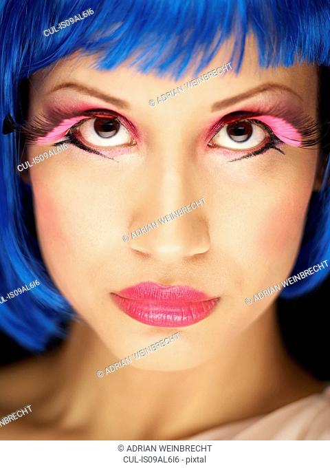 Young woman wearing fake eyelashes