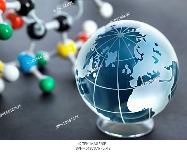 Global research, conceptual image. Glass globe and molecular model