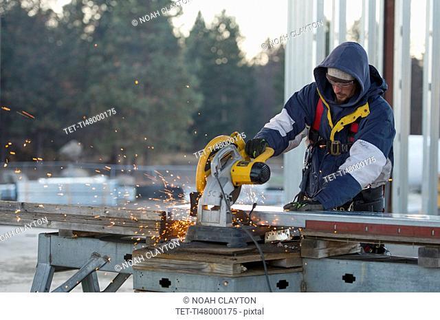 Man cutting steel bar