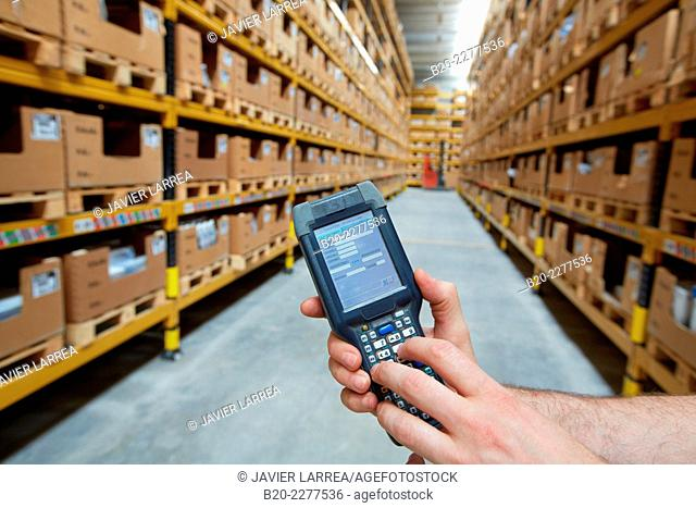 Barcode reader. Boxes with industrial parts. Warehouse palletizing