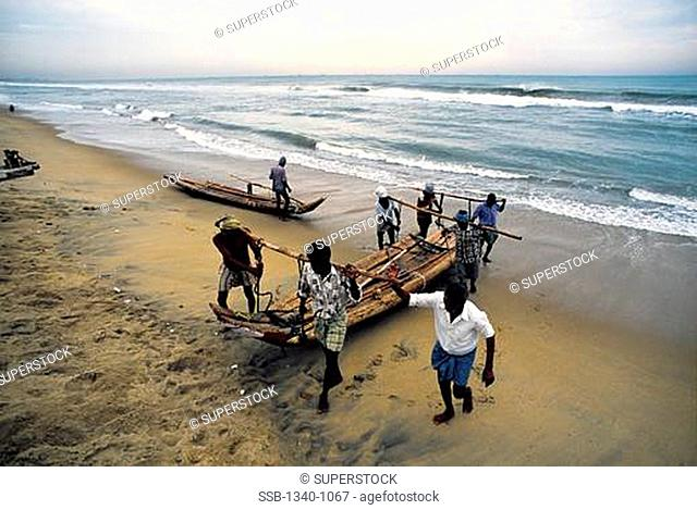 Fisherman working on the beach, Marina Beach, Bay Of Bengal, Chennai, Tamil Nadu, India