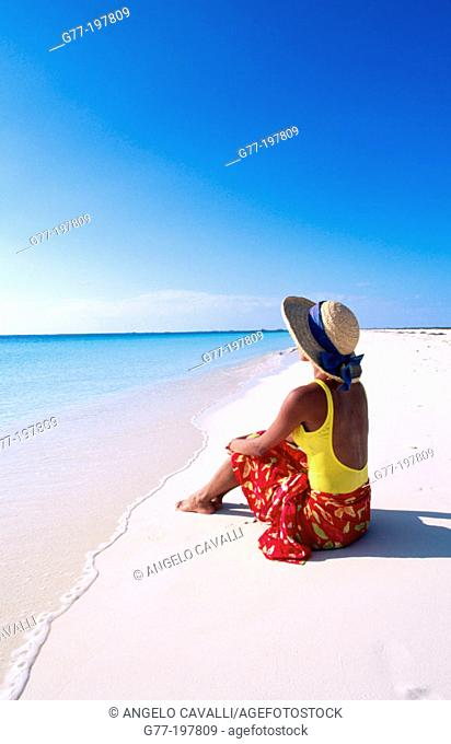 Woman on tropical beach. Cayo Largo. Cuba