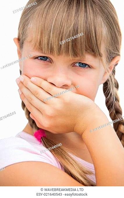 Beautiful little girl with her hand on her mouth