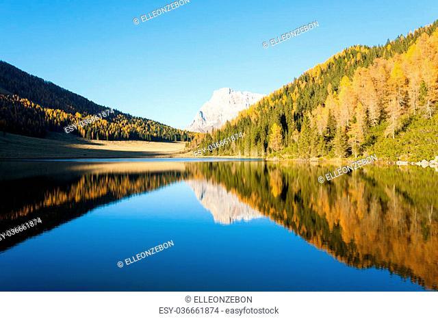 "Mountain panorama from Italian Alps. Reflections on water from """"Calaita"""" lake. Beautiful dolomites"