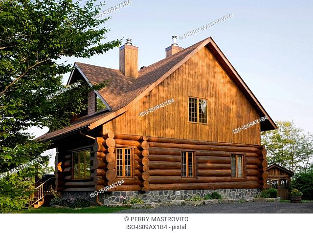 Exterior of cottage style log house with cedar shingles