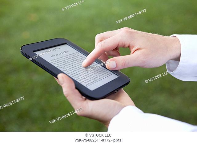 USA, Illinois, Metamora, hands holding e-book