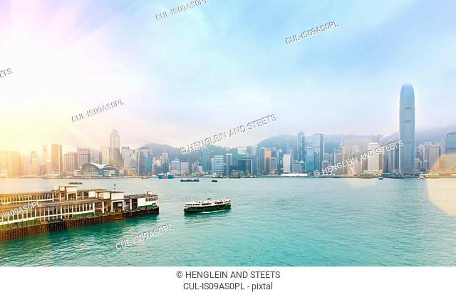 Central Hong Kong skyline and Star Ferry crossing Victoria harbor, Hong Kong, China