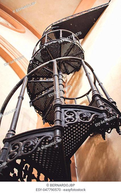Photograph of an old metal spiral starway