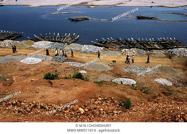 Mari River in Jaflong, Bangladesh The river coming from the Himalayas of India brings million tons of stone boulders with its tide Stones and boulders collected...
