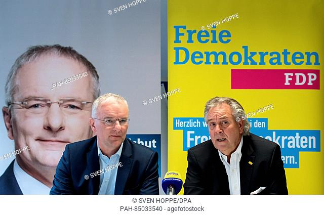 The future Lord Mayor of Landshut, Alexander Putz (l, FDP) and the FDP (Free Democratic Party) President Albert Duin speaking during a press conference in...